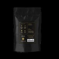 2 oz. packaging for Golden Assam loose leaf black tea from The Jasmine Pearl Tea Co.