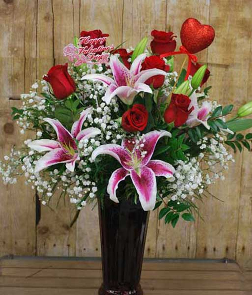 roses and lilies arranged