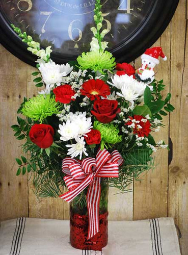 Arrangement available in either a silver or red mercury bottom vase