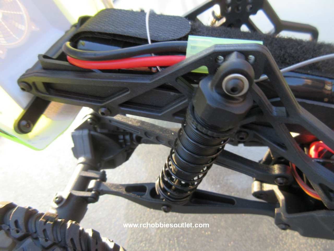 Battery Holder and Mid Rear Positioned Shock Absorber