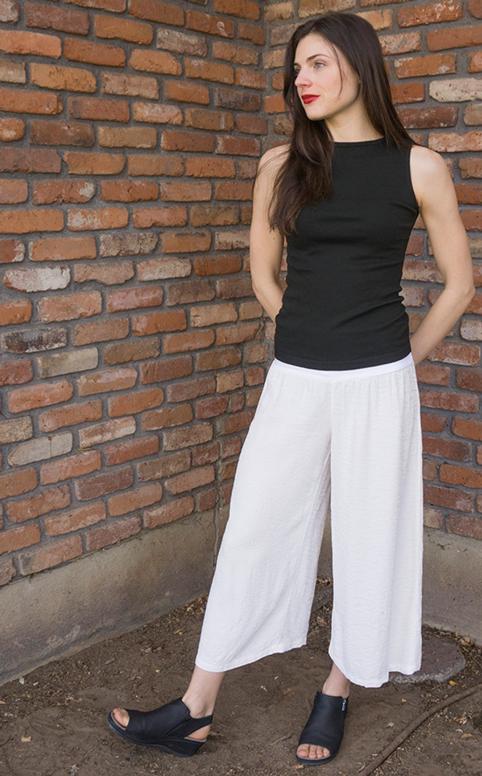 Taylor in small Rayon Calypso Pants, in white, paired with the Boatneck Tank.