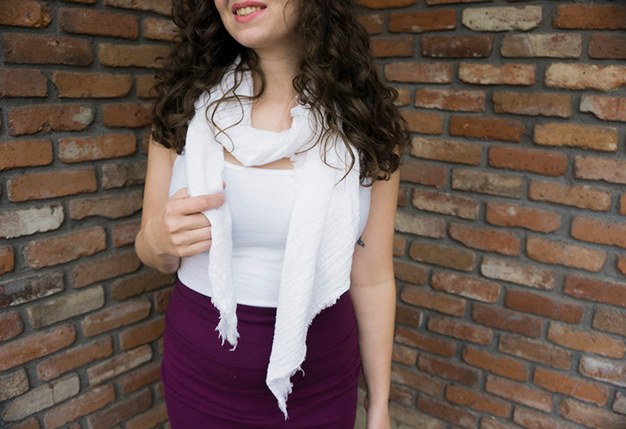 White scarf, paired with lycra tank.