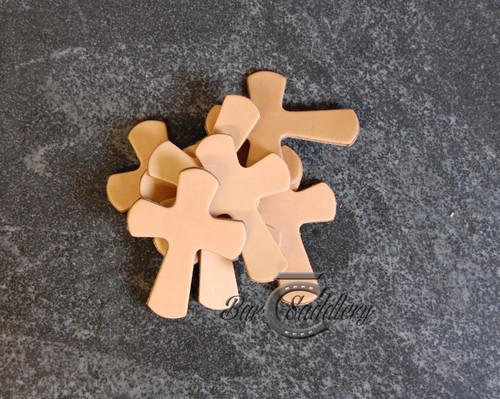 Bulk die cut vegetable tanned leather crosses. Great for DIY saddle crosses