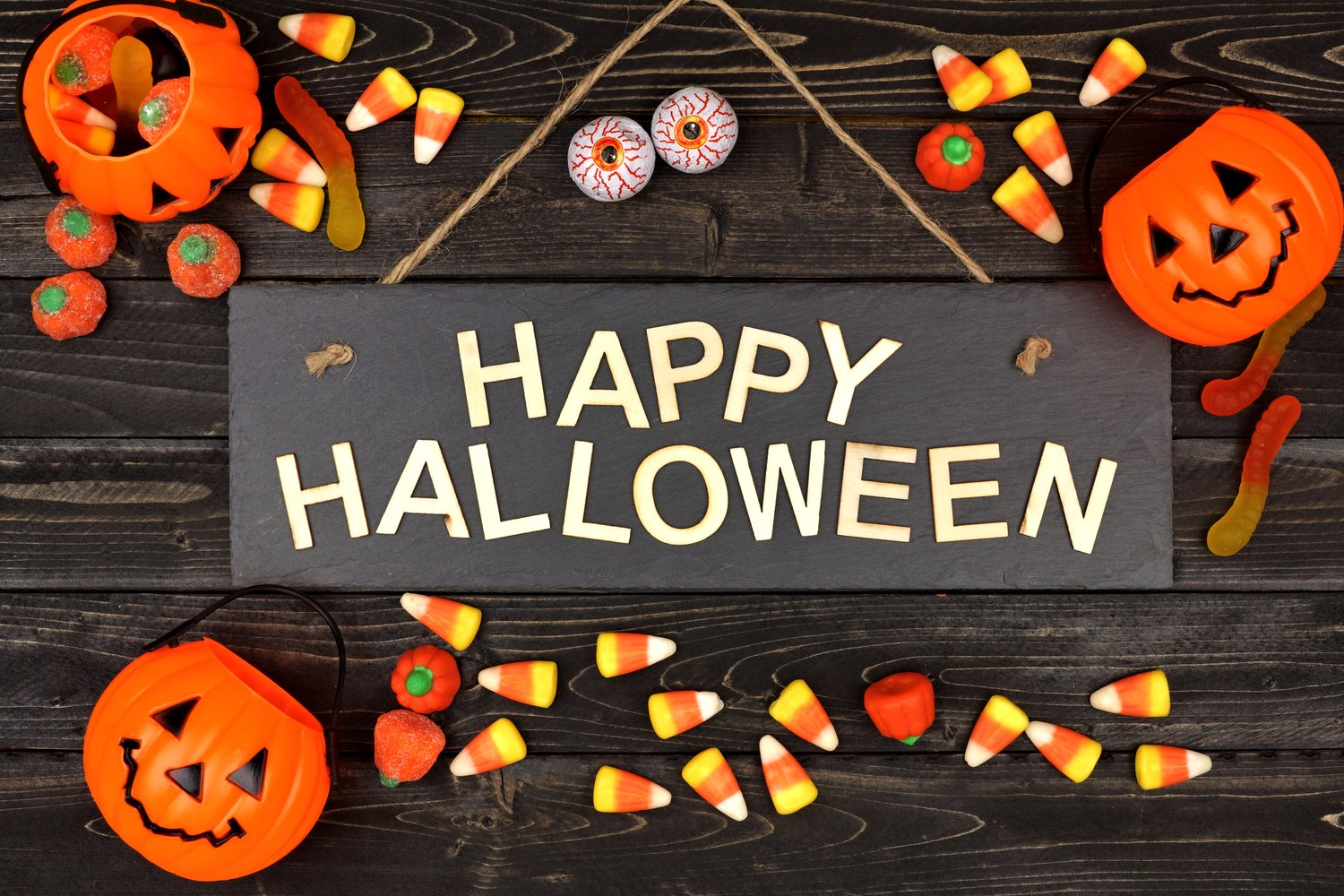 happy-halloween-sign-and-frame-of-candy-on-black-wood-841992038-6000x4000.jpeg