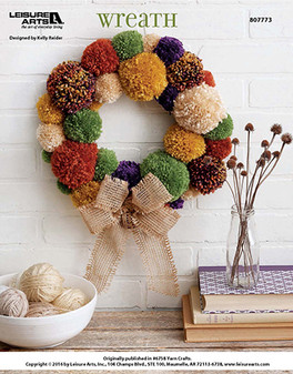 Pick up your newest crafting project with this unique and color-popping yarn pom-pom wreath! Designed by Kelly Reider.