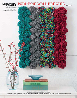 Show your love for pom-pom decor by crafting this unique wall hanging that could brighten up any corner of the house! Designed by Kelly Reider.