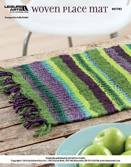 Perfect for placement all year around, weave this simple and colorful place mat with yarn to add a little extra table pop during any family meal or celebration. Designed by Kelly Reider.