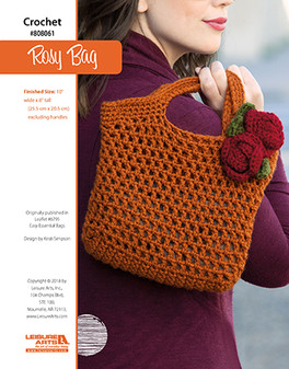 Crochet a charming bag that is perfect for a trip to the mall or market that features a rosy red flower to top off this timeless pattern. Designed by Kristi Simpson.