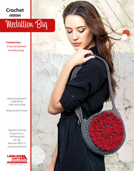 Stylish yet simple, this Medallion Bag can compliment any outfit that you put to it. Designed by Kristi Simpson.