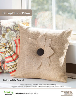 If you're a lover of flowers and floral, then sew up this simple and sweet burlap flower pillow. Designed by Billie Steward.