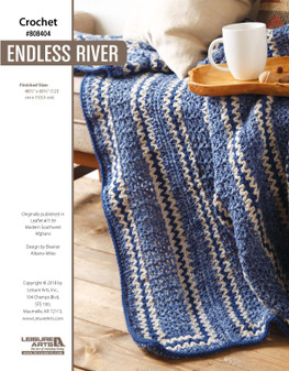 """Feel your stress flow away with the current this beautiful crocheted afghan. Finished size 48.5""""x 60.5""""."""