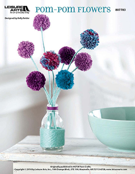No need to water these flowers! Just sit back, relax, and craft you own little pom-pom blooms. Designed by Kelly Reider.