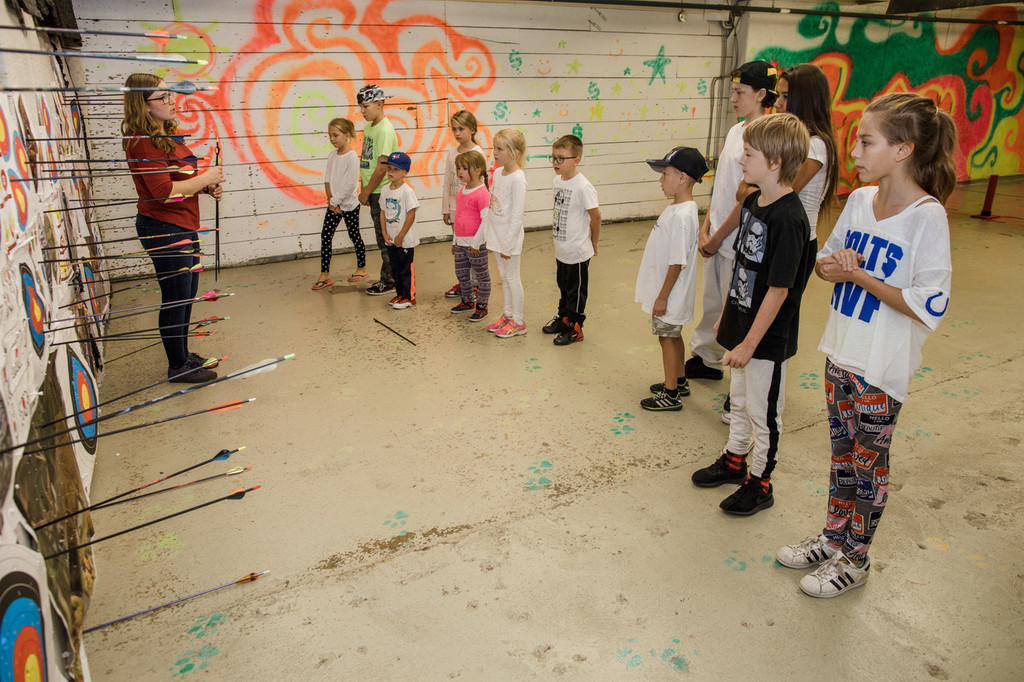 learning how to collect arrows safely archery winnipeg birthday party kids youth