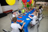 Eating Pizza kids birthday party winnipeg archery kids youth