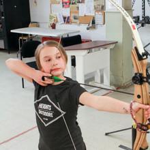 ARCHERY LESSONS WINNIPEG MANITOBA CANADA CLASS LEARN KID YOUTH ADULT FUN ACTIVITY GIRL BOY