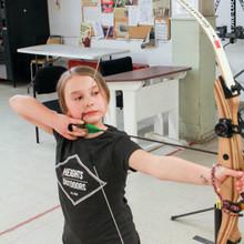 GIRL BOY YOUTH ADULT FAMILY FUN ARCHERY LESSONS LEARN TEACH COACH WINNIPEG MANITOBA CANADA HEIGHTS ARCHERY ACADEMY WINNIPEG MANITOBA CANADA