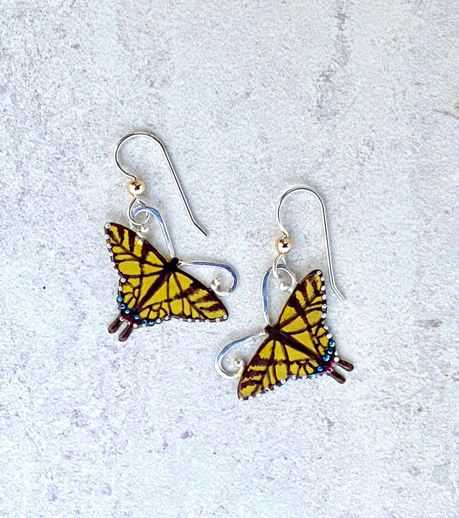 """Tiger Swallowtail Earrings are a tribute to the flash of yellow that we are lucky to see in the summer. They are handcrafted from jeweler's brass and Sterling silver, and carefully handpainted. They measure 1"""" x 1"""", and are light as a butterfly."""