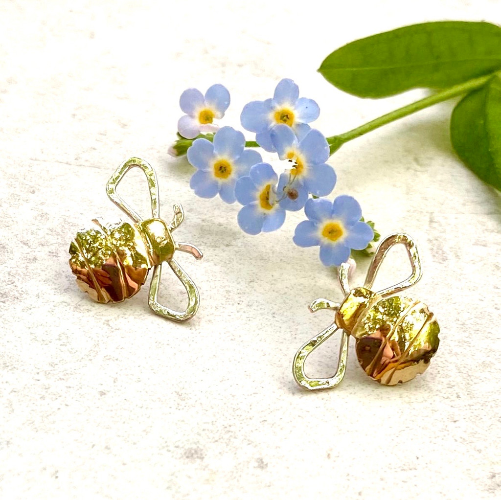 "Bumble bees are the life of a garden. These little bee post earrings serve as a reminder of the beauty of liveliness of gardens and the great outdoors. I make them out of jeweler's brass and Sterling and lacquer them so as to make them care-free. They measure 1/2""x1/2"". They are a great gift for a friend or you!"