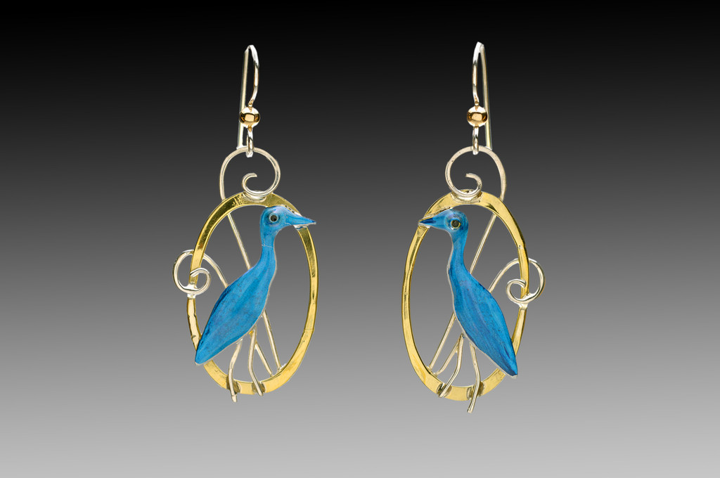 """It is said that the sight of a heron is good luck, so wearing Heron Earrings is sure to bring good fortune, also. These are handcrafted from jeweler's brass and Sterling silver, and carefully handpainted. They measure 3/4"""" x 1 3/8"""", and are light as a feather."""