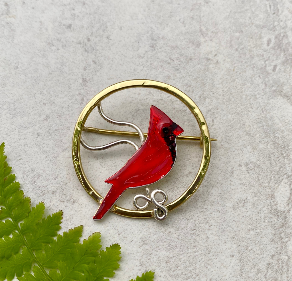 """This Cardinal Pin captures the thrill of seeing that flash of red. It is handcrafted from jeweler's brass and Sterling silver, and then carefully hand-painted and sealed. Its diameter is 1 1/4""""."""