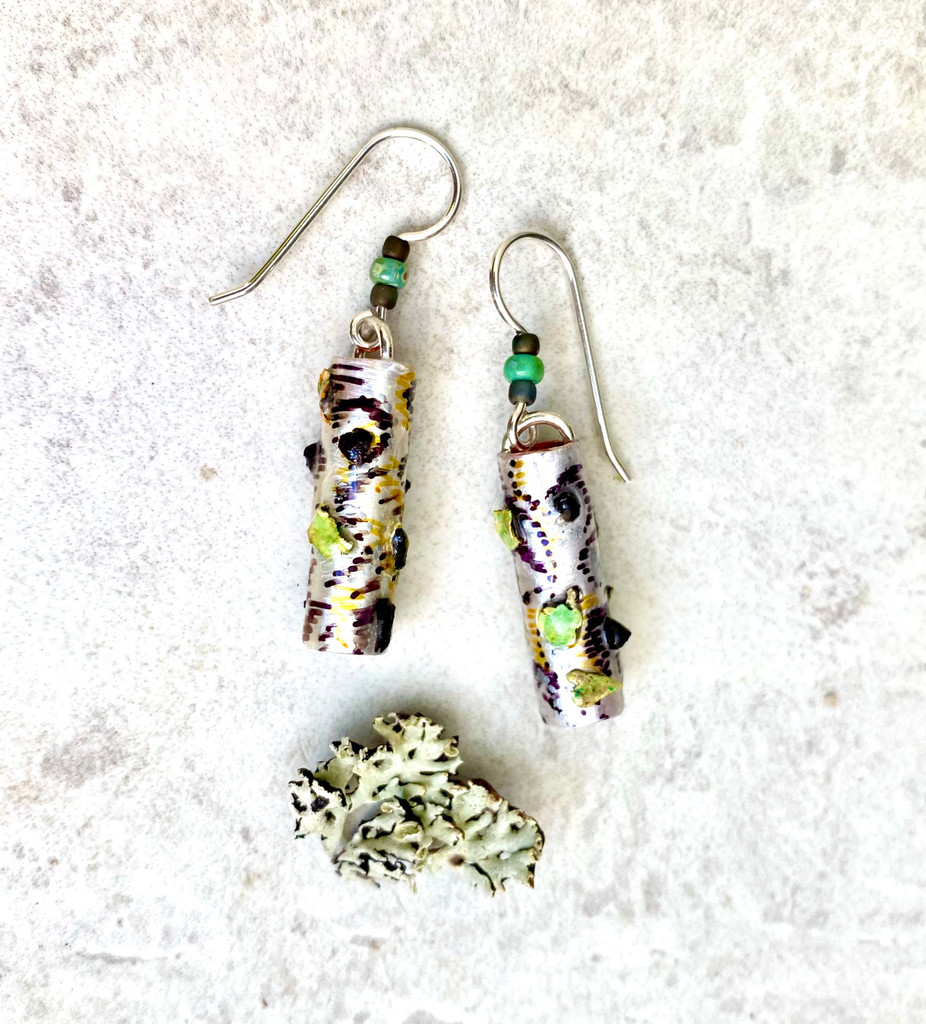 """Wear the Woods! Earrings are the next best thing to being there. The birch tree trunks feature real lichen and chaga mushrooms, as well as the sense of peace that forests project. Color and real flora is carefully applied and they are finished with three protective clear coats, including resin for depth and durability. They measure 1.25"""" long, not including the earring wires. Earring wires are Sterling silver. They are the perfect give for a friend or for yourself."""