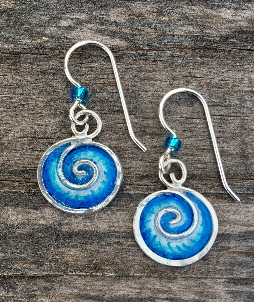 "Ocean waves and waterfalls emit feel-good negative ions. These blue wave earrings may not emit ions, but wearing them does promote hope and peace. They are handmade out of sterling silver and resins, and are carefully hand painted. They measure 3/4"" tall x 1/2"" wide. They are light and fun to wear."