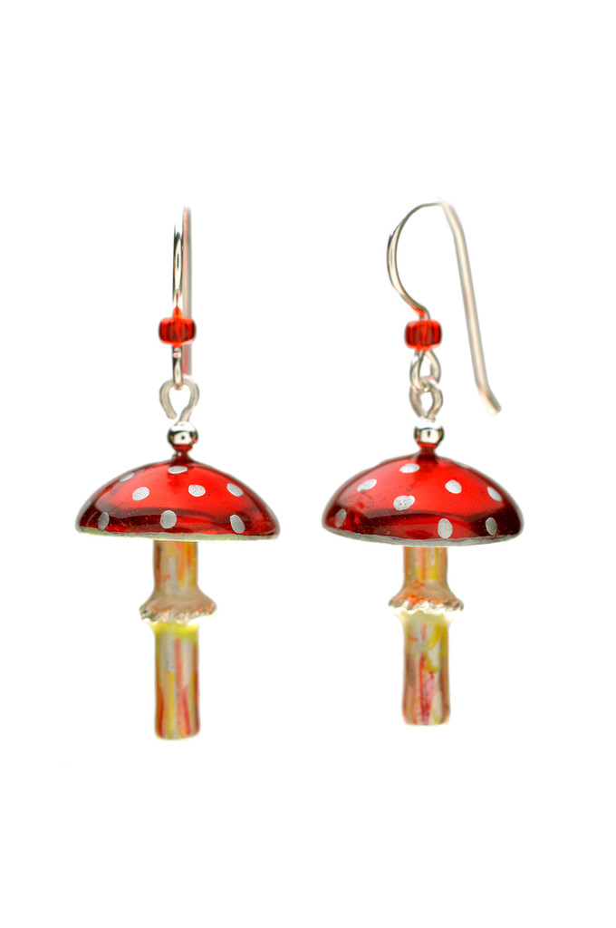 "Mushrooms symbolize the beauty and magic of nature, and the amanita muscaria is the quintessential mushroom. It is the mushroom that was featured in Alice in Wonderland, and was the subject of European folklore, and often represented in Christmas tree ornaments. These earrings pay homage to these mushrooms, and to the fields and forests where they are found. They are handcrafted from jeweler's brass and Sterling, and carefully hand-painted, and sealed with 4 protective clear coats, the final one being a jewelry grade resin for the ultimate durability. The stems dance lightly beneath the caps, and bits of the decorative elements will glow in the dark after being exposed to bright light for several minutes. The measure a scant 3/4""wide and 1"" long without the earring wires. These earrings are light and fun to wear, and make great gifts, too."