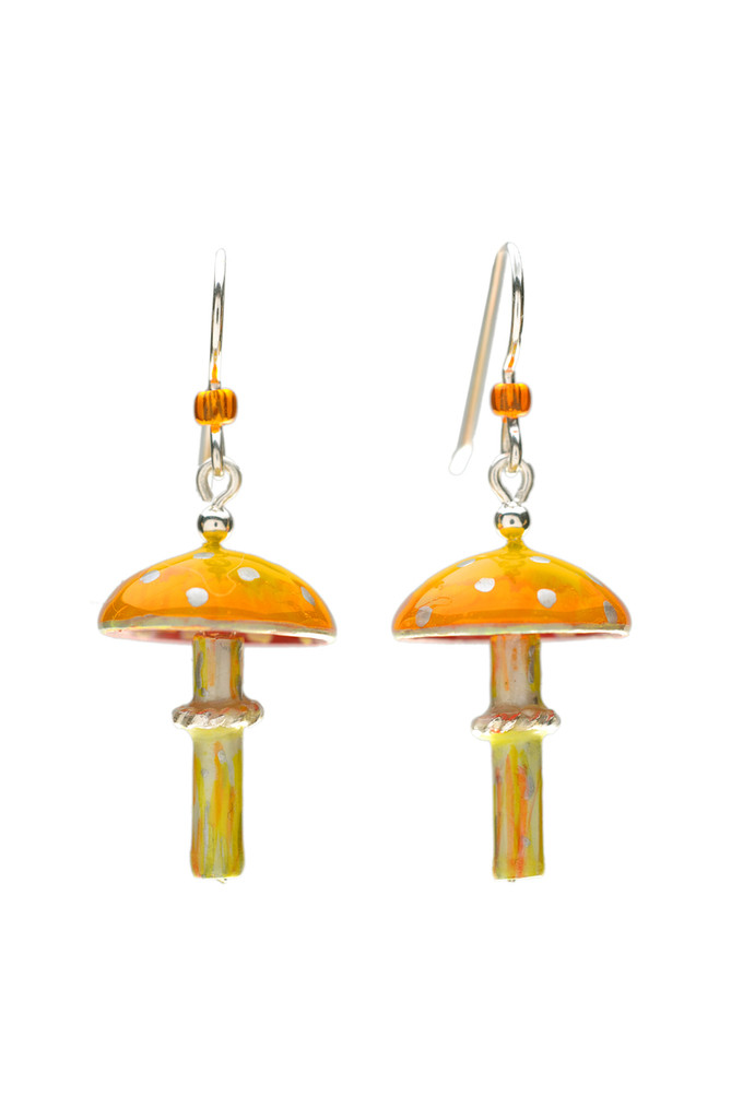 """Mushrooms symbolize the beauty and magic of nature, and the amanita muscaria, or fly agaric, is the quintessential mushroom. It is the mushroom that was featured in Alice in Wonderland, and was the subject of European folklore, and often represented in Christmas tree ornaments. These earrings pay homage to this and all mushrooms. They are handcrafted from jewelry's brass and Sterling, and carefully hand painted, and sealed with 4 protective clear coats, the final one being a jewelry grade resin for the ultimate durability. The stems dance lightly underneath the caps. And it gets better! Bits of the decorative elements will glow in the dark after being exposed to bright light for several minutes. They measure a scant 3/4"""" wide and 1"""" long without the earring wires. Earring wires are Sterling but can be replaced with the ultimate hypo-allergenic niobium by request. These earrings are light and fun to wear, and make great gifts, too."""