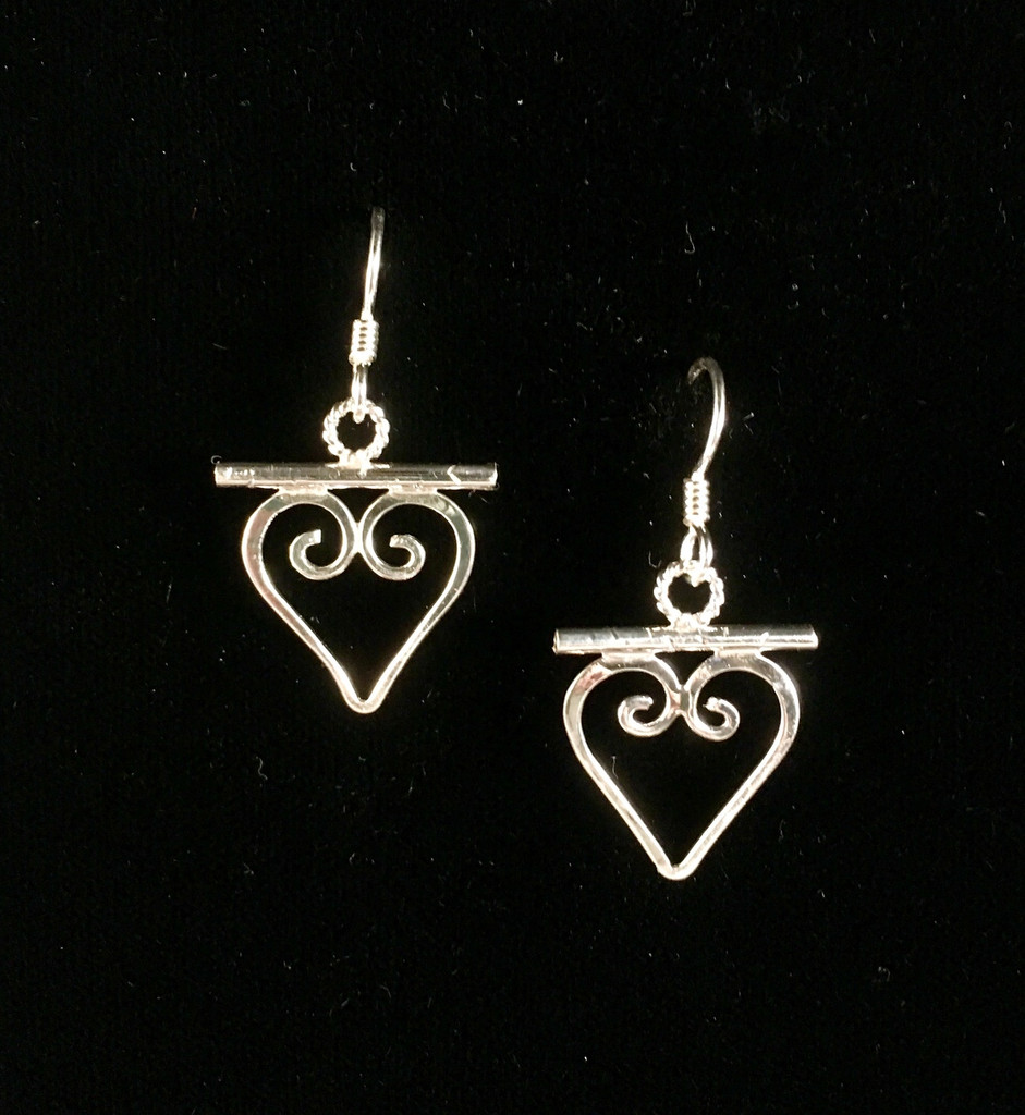 """Since hearts speak the universal language of love, wearing them spreads it through the environment. These earrings are handcrafted from Sterling silver and measure .75"""" wide x 1"""" tall, not including the Sterling earring wires. They spread good vibes and are fun to wear and to give."""