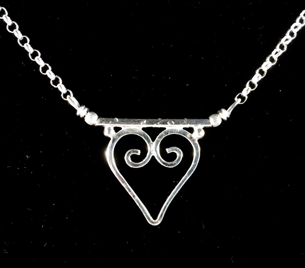 "If love is what makes the world go round, then wearing it only helps this noble cause. This heart-shaped necklace is handcrafted out of Sterling silver and measures 17.5"" long. It is a lovely piece that  is fun to give and to wear."