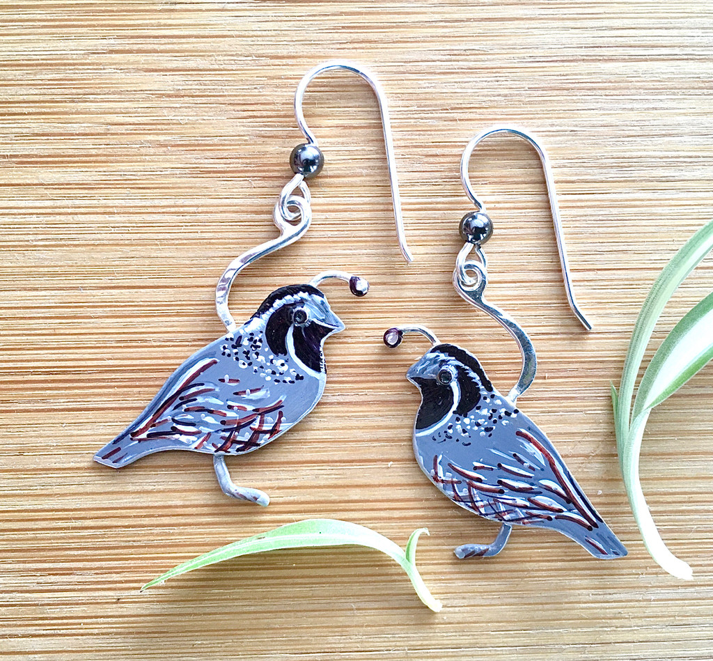 "Who doesn't love the sight of a quail, with its inquisitive nature and amusing gait? These earrings are both a reminder of and a tribute to this wonderful bird. I make them out of Sterling and jeweler's brass, and carefully handpaint each one. They are sealed with jeweler's resin for durability. They measure 1"" wide x 1 1/4"" tall, not including the Sterling earring wires. They are light and comfortable, and fun to give and to wear!"