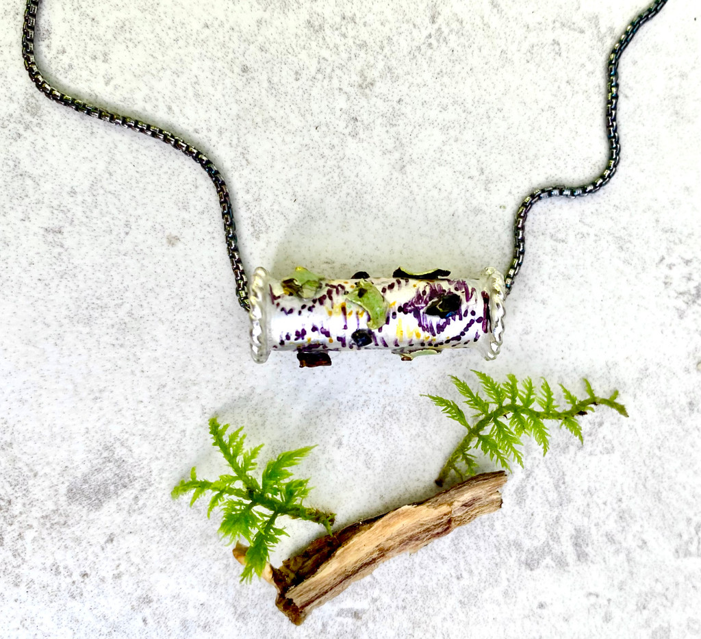 """Wear the Woods! Necklace is the next best thing to being there. The birch tree trunk featured real lichen and chaga mushrooms, as well as the sense of peace that forests project. Color and real flora are carefully applied and it is finished with a resin clear coat for depth and durability. The birch slide measures 1"""" wide and the Sterling rounded box chain is 18"""". It is the perfect gift for yourself or a friend."""