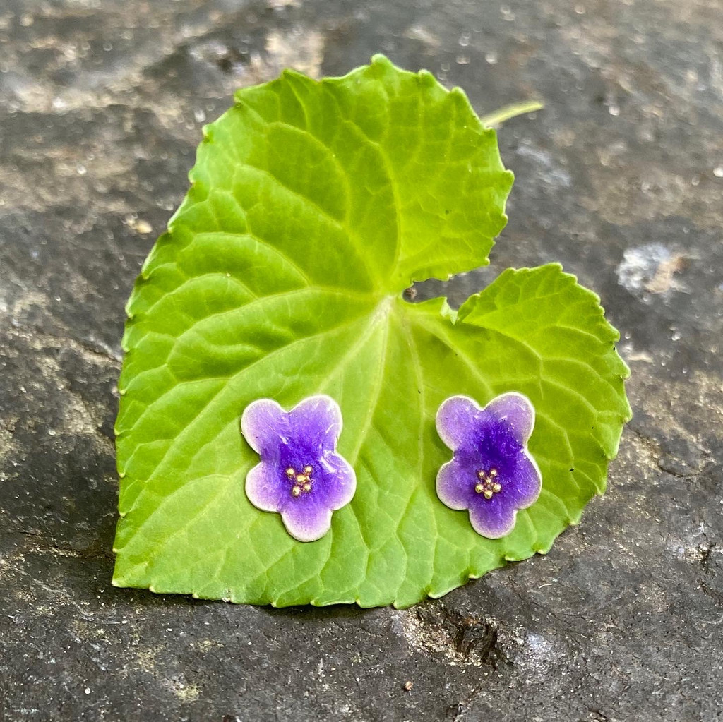 """Violets symbolize the newness and glory of spring all year long. These Violet Post Earrings do this also. They are handmade out of Sterling silver, and carefully handcolored. They measure 5/16"""" wide by 3/8"""" tall. They are the perfect gift for a friend or for yourself!"""
