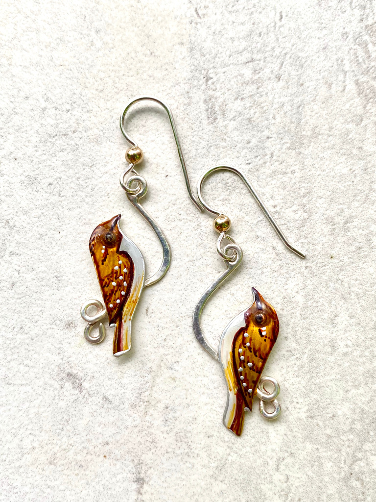 "Brown Creepers are a sweet songbird and the only member of the treecreeper family in North America. They can be seen spiraling upwards on tree trunks in search of insects. These earrings are a tribute to this very special bird. They are hand crafted out of jeweler's brass and Sterling and carefully hand painted. They measure 1/2"" wide by 1 1/4"" long, not counting their Sterling earring wires. They are light and comfortable to wear, and are the perfect gift for you or a friend."