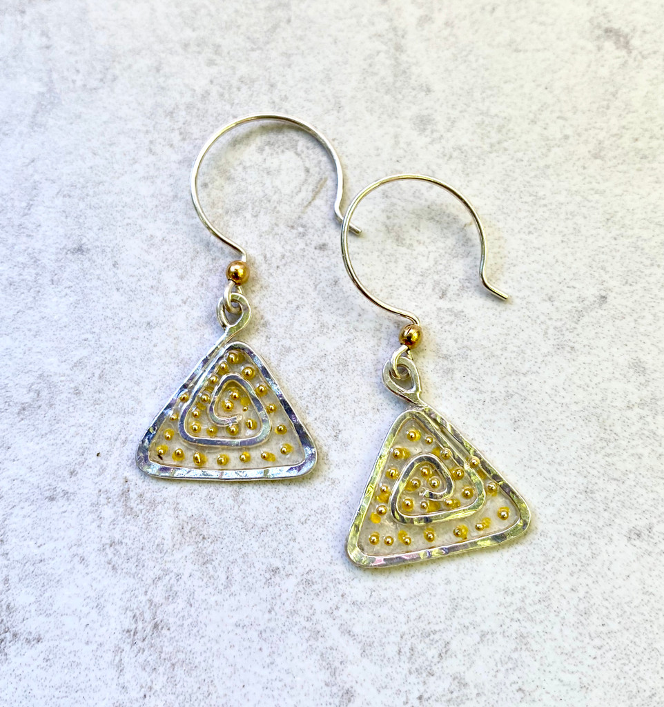 """We can all use a lift from time to time these Lighter Than Air Earrings provide just that; a touch of the ethereal. They are handcrafted from Sterling silver feature translucency (what a great word and concept!) that supports golden accents. They literally float when worn and add a bit of subtle sparkle. They measure 3/4"""" wide by 3/4"""" tall, not including their Sterling earring wires. They are light and fun to wear and make the perfect gift for a friend or you!"""