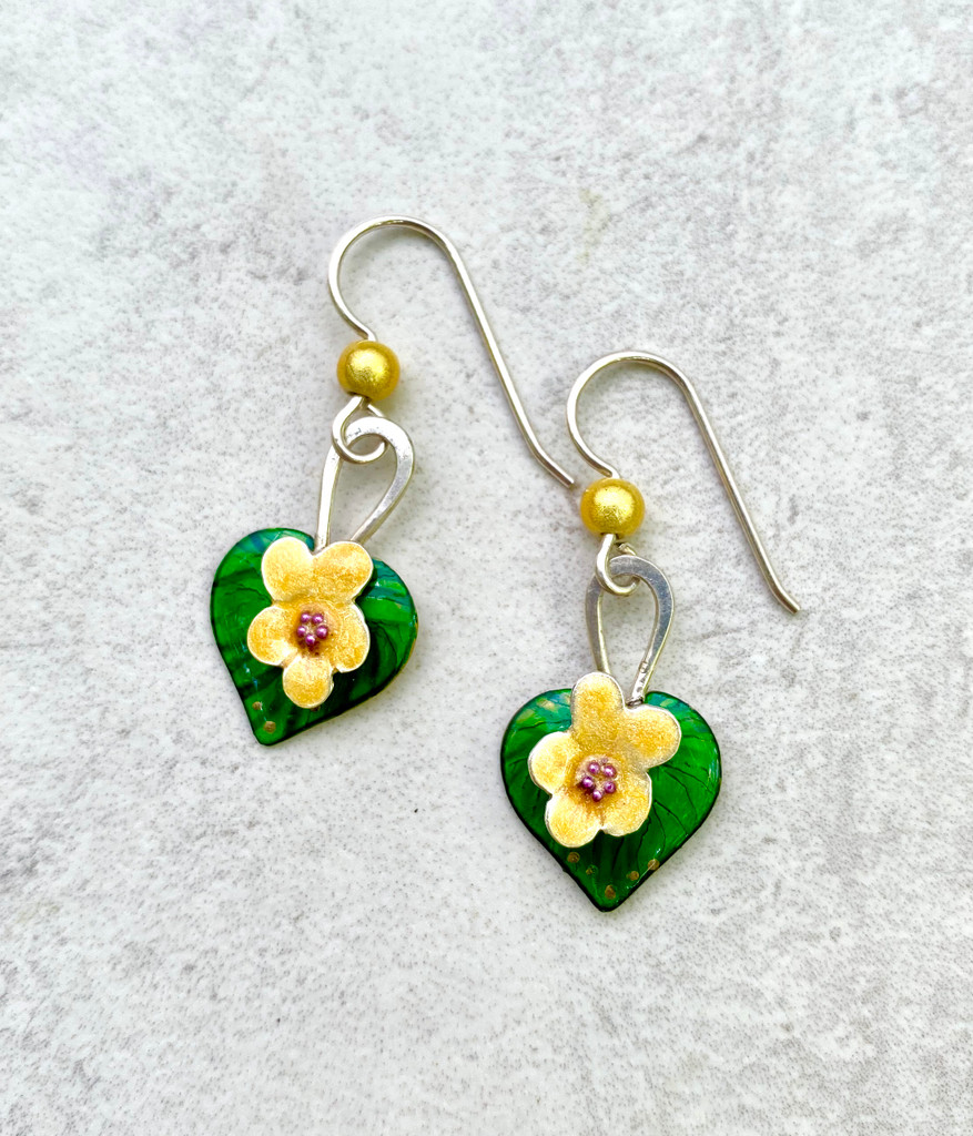 """Not all violets are blue (or purple), and Yellow Violet earrings are a lovely reminder of this. They are carefully handcrafted out of Sterling and jeweler's brass and meticulously hand-colored. They measure 3/4"""" tall by 1/2"""" wide, not including the Sterling earring wires. They are light to wear, and would be the perfect gift for a friend or you!"""