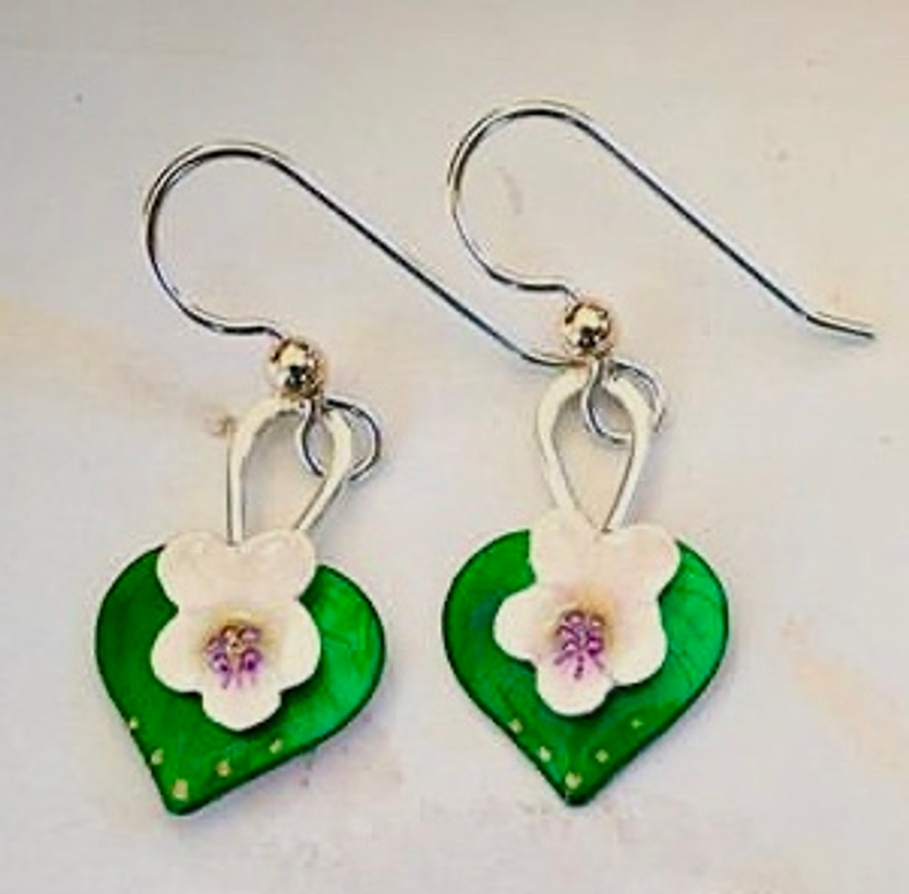"""Not all violets are blue (or purple), and White Violet earrings are a lovely reminder of this. They are carefully handcrafted out of Sterling and jeweler's brass and meticulously hand-colored. They measure 3/4"""" tall by 1/2"""" wide, not including the Sterling earring wires. They are light to wear, and would be the perfect gift for a friend or you!"""