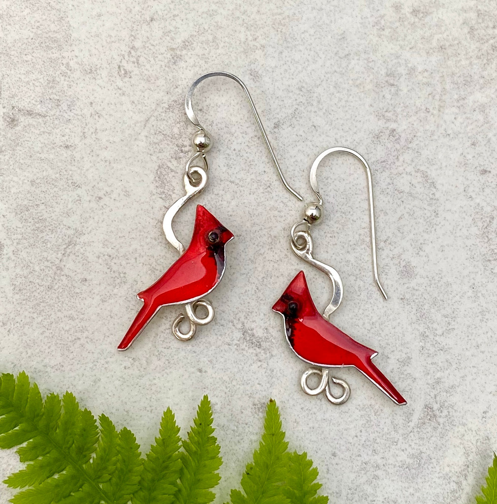 """Because wearing these cardinal earrings is as special as seeing one...These Small Cardinal Earrings feature two male cardinals. They are handcrafted from jeweler's brass and Sterling silver, and then carefully handpainted. They measure 3/4"""" x 7/8"""", not including the Sterling earring wires, and are as light as a feather."""