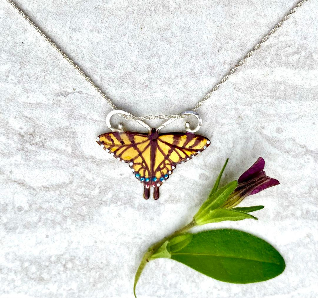"""This Tiger Swallowtail Necklace is a tribute to the flash of yellow that we are lucky to see in the summer. It is handcrafted from jeweler's brass and Sterling silver, and carefully handpainted. It measures 1"""" wide by 3/4"""" tall and is strung on a 16"""" Sterling chain. It would also work on an 18"""" chain. If you would prefer the 18"""" one, let me know in the notes."""
