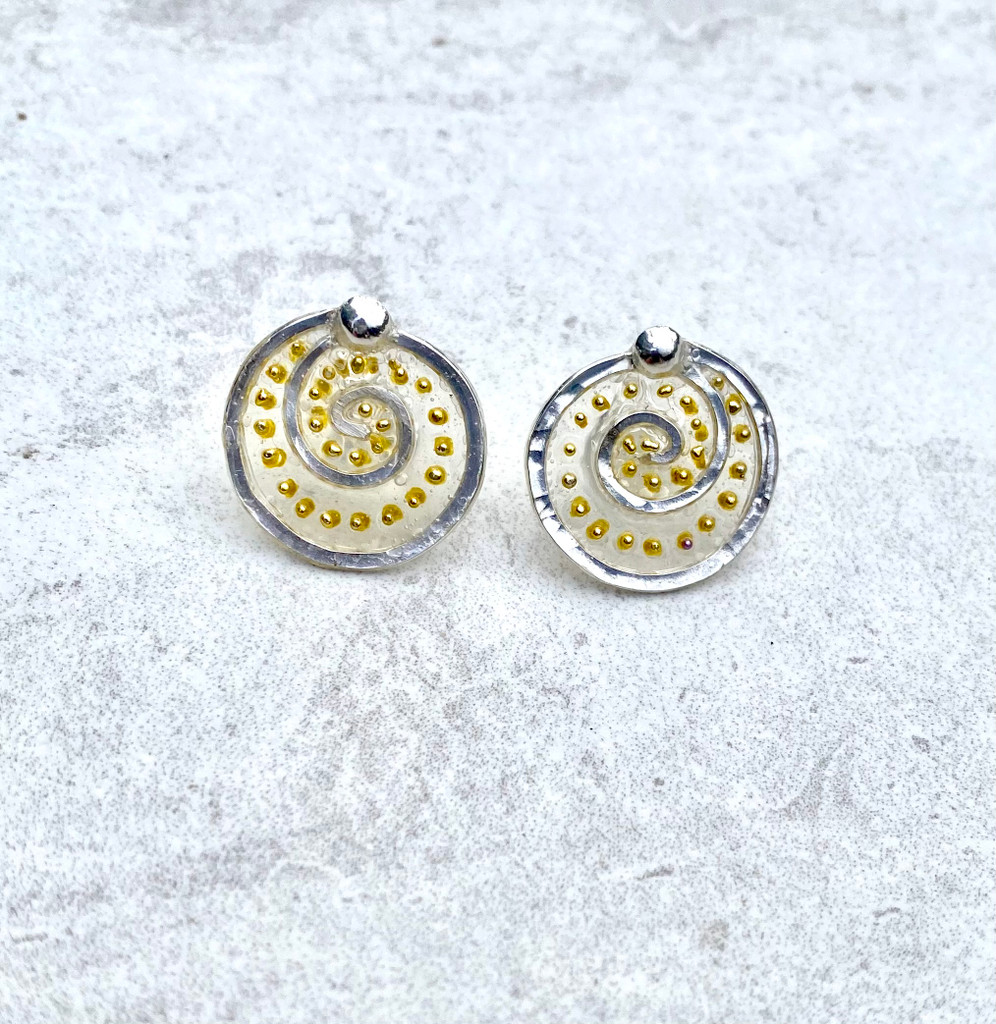"""We can all use a lift from time to time, and these Lighter Than Air Post Earrings provide just that; a touch of the ethereal. They are hand crafted from Sterling silver and have translucency that supports golden accents. They bring a sense of lightness and add a bit of subtle sparkle. Their diameter is a bit more than 5/8"""" and they hang gently from the ear. They are light and comfortable to wear and are the perfect gift for a friend or for you!"""