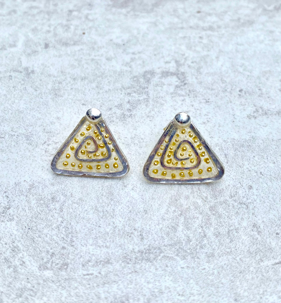 "We can all use a lift from time to time these Lighter Than Air Pyramid Post Earrings provide just that; a touch of the ethereal. They are handcrafted from Sterling silver feature translucency (what a great word and concept!) that supports golden accents. They sit comfortable on the ear when worn and add a bit of subtle sparkle. They measure 5/8 wide by 5/8"" tall and have Sterling earring posts. They are light and fun to wear and make the perfect gift for a friend or you!"