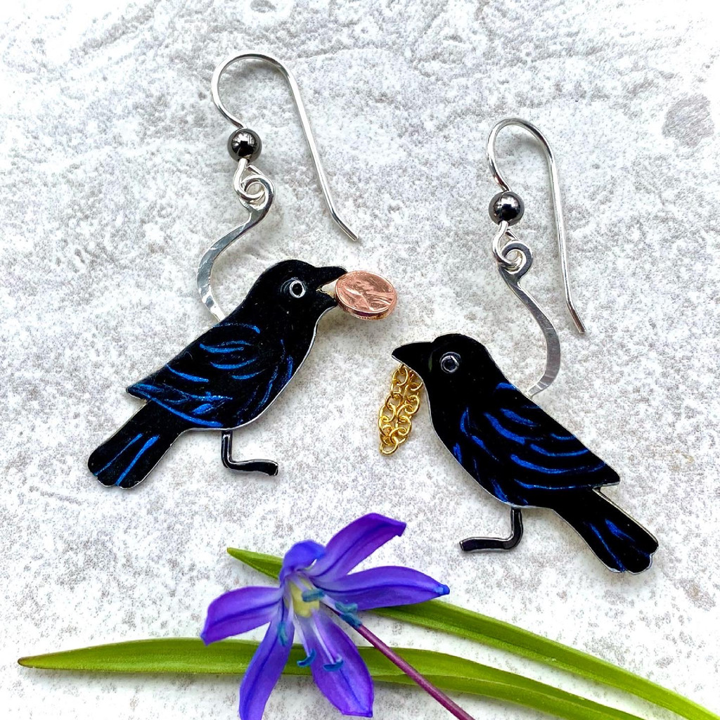 """Crows or ravens, ravens or crows? The choice as to which remarkable bird these earrings pay tribute to is yours. I am a fan of both, so am not leaning either way. Both birds have a tendency to collect colorful and shiny objects, which is a trait that many of us can respect and relate to, speaking for myself, anyway. I make them out of Sterling, jeweler's brass, a miniature coin (cool, eh?) and a snippet of shiny chain. They are handpainted with enamel paints, and sealed with jeweler's resin. They measure 1 1/4"""" tall by 1"""" wide, not including the Sterling earring wires.   And as an aside. they were inspired by the recent find of a raven's skull under a stand of tall white pines where we hear the ravens talking (and they really do talk!). I considered this to be a gift from the world, and the earrings are my response....which doesn't mean that they couldn't be crows, of course."""