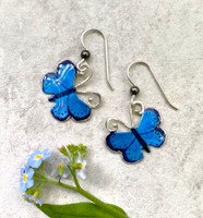 """The karner blue butterfly is endangered due to the loss of its foodsource, the wild lupine, or lupinus perennis. Due to the efforts of school children replanting this native wildflower, the karner blue is making a come-back. These Karner Blue Butterfly Earrings are a tribute to this special butterfly, and to the efforts of these children. The earrings are handcrafted from jeweler's brass and Sterling silver, and carefully hand-painted. They measure 7/8"""" x 7/8"""" and are light as....what else?...a butterfly."""