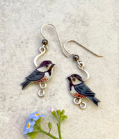 "Who doesn't like the happy energy of the chickadee? These Chickadee Earrings are a tribute to this favorite bird. They are hand crafted out of Sterling silver and jeweler's brass, and then carefully handpainted. They measure 3/4"" wide by 1"" tall, not including the Sterling earring wire. They are light and comfortable to wear, and are the perfect gift for a friend or for you!"