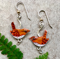 """Who doesn't love wrens? Their inquisitive nature and lightness are always a thrill to witness. These earrings are a tribute to wrens. They are hand-fabricated out of Sterling and jeweler's brass and carefully hand-painted, making each one unique. They are finished with a layer of protective resin. They measure 3/4"""" x 1"""". They are light and comfortable to wear and are the perfect gift for yourself or a friend."""