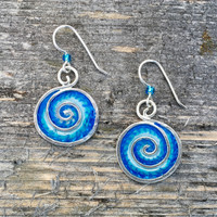 "Ocean waves and waterfalls emit feel-good negative ions. These earrings may not emit the actual ions, but they will promote feelings of hope and peace. They are handmade from sterling silver and resins, and carefully hand painted. They measure 1"" tall and 3/4"" wide, not including the earring wires, and are light and fun to wear."
