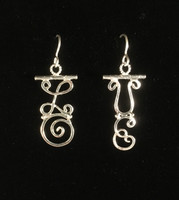 """These earrings serve as a reminder that love makes the world go round 365 days a year. They are hand-fabricated out of Sterling silver, and hang lightly. They measure 1.25""""x3/4"""", not including the earring wires. They are fun to wear and fun to give!"""