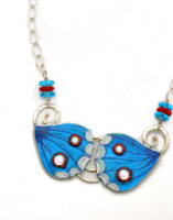 """Blue Pansy Butterflies are yet one more example of the exquisite beauty of the natural world. These earrings are a tribute to them. They are handcrafted out of Sterling, jeweler's brass, carefully selected and applied color, and sealed with resin for durability. The necklace is 20"""" long, and can be adjusted to be worn shorter. It is light and colorful, and fun to wear and to give."""
