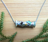 """Wear the Woods! Necklace is the next best thing to being there. The birch tree trunk features real lichen and chaga mushrooms, as well as the sense of peace that forests project. Color and real flora are carefully applied and it is finished with a resin clear coat for depth and durability. The birch slide measures 1"""" wide and the Sterling rounded box chain is 18"""". It is the perfect gift for yourself or a friend."""