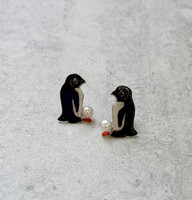 """Who doesn't love penguins, and who wouldn't love wearing them? These penguin post earrings are handmade from Sterling silver, and carefully hand-colored. They feature fresh-water pearl """"eggs"""", as precious as the real things. They measure 3/8"""" wide by 5/8"""" tall. They are a great gift for a friend or for yourself."""